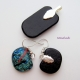 View of backs of pendant and earrings, silver plated bails