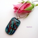 Teal fused dichroic glass cabochon pendant shown with silver snake chain