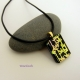 Pendant shown with black leather cord